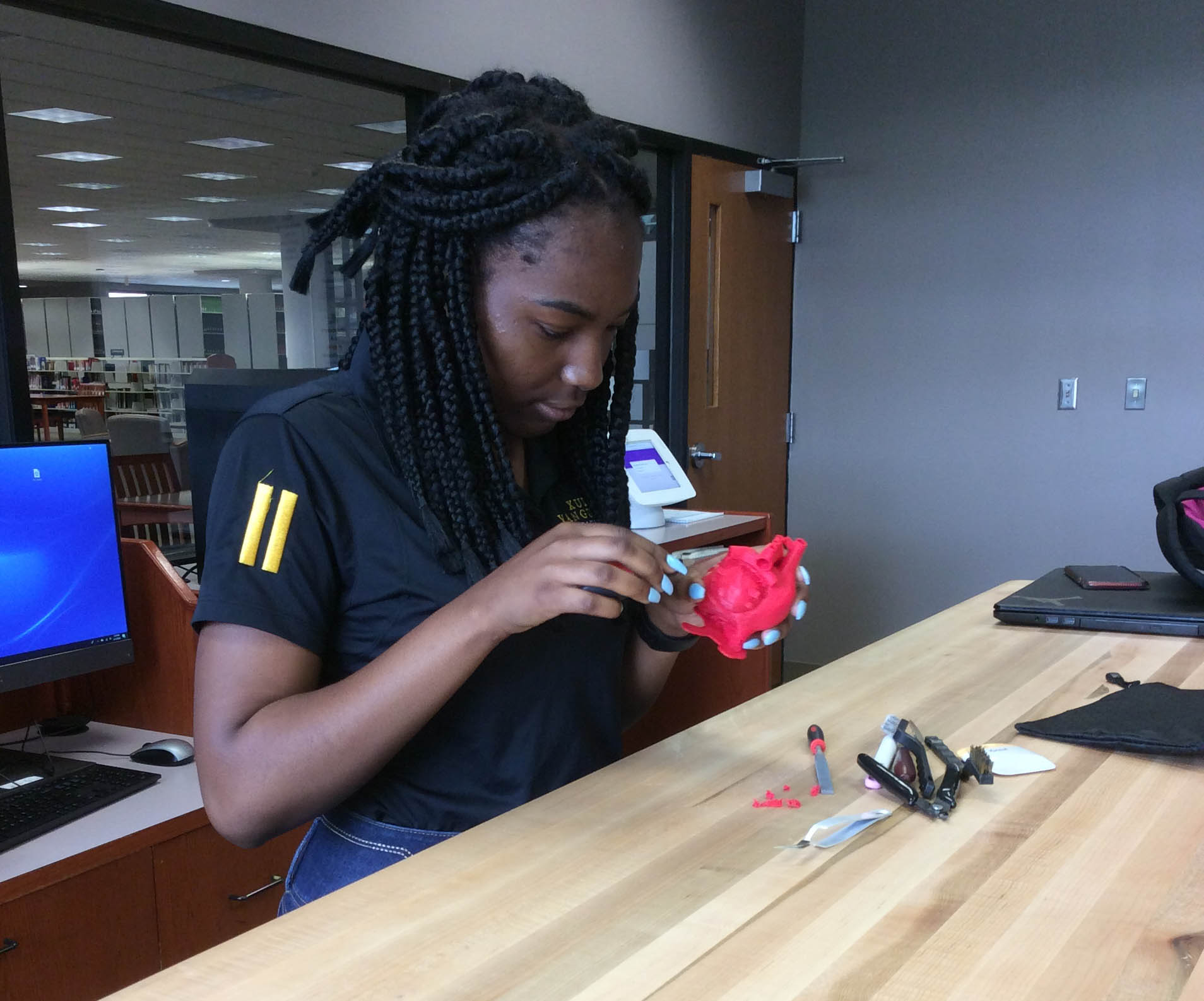Student Working on 3D Printed Object