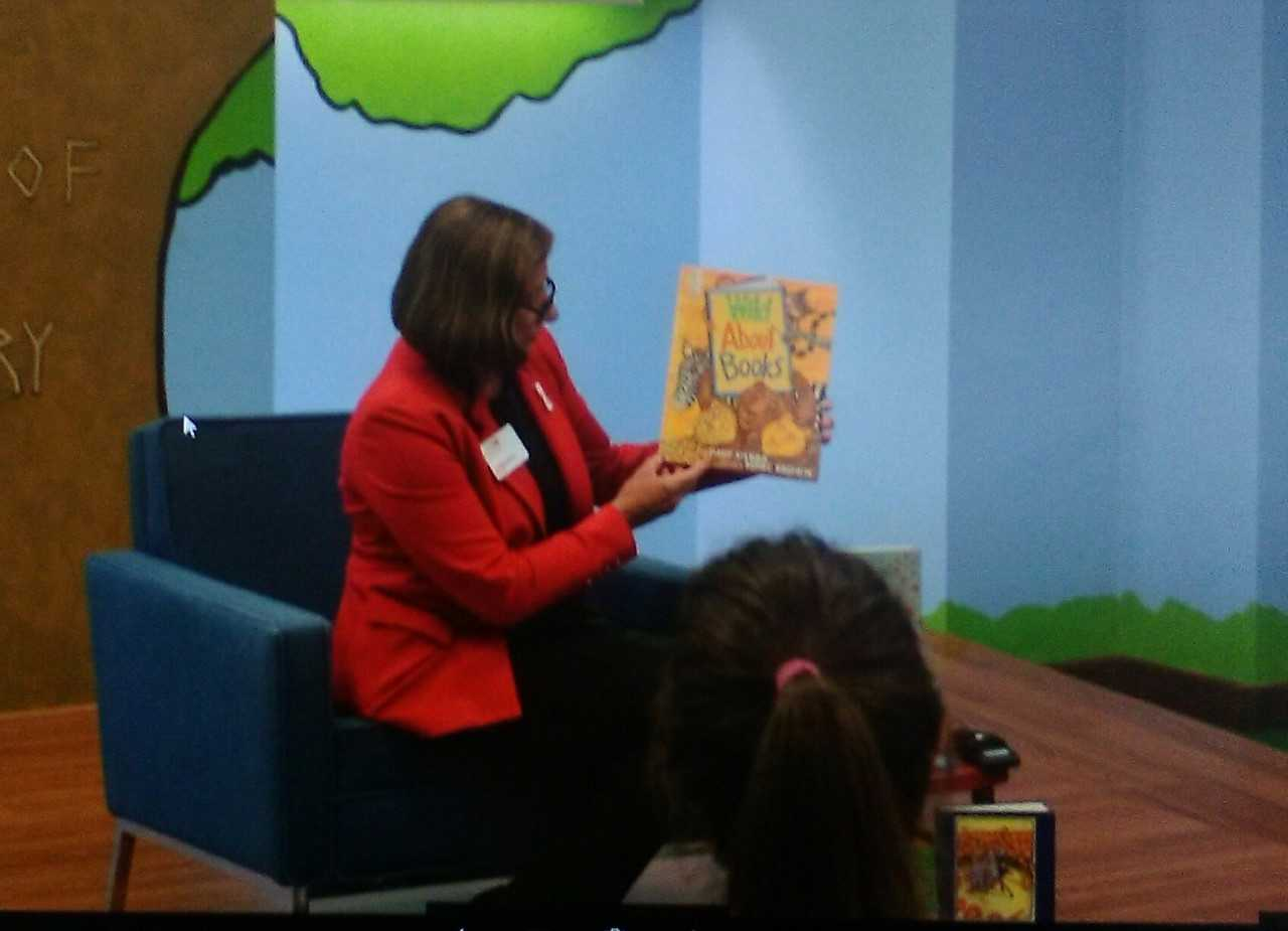 Dr. Pamela Beehler, First Lady of Jacksonville State University, breaks in the Children's Corner with a read aloud of Wild about Books