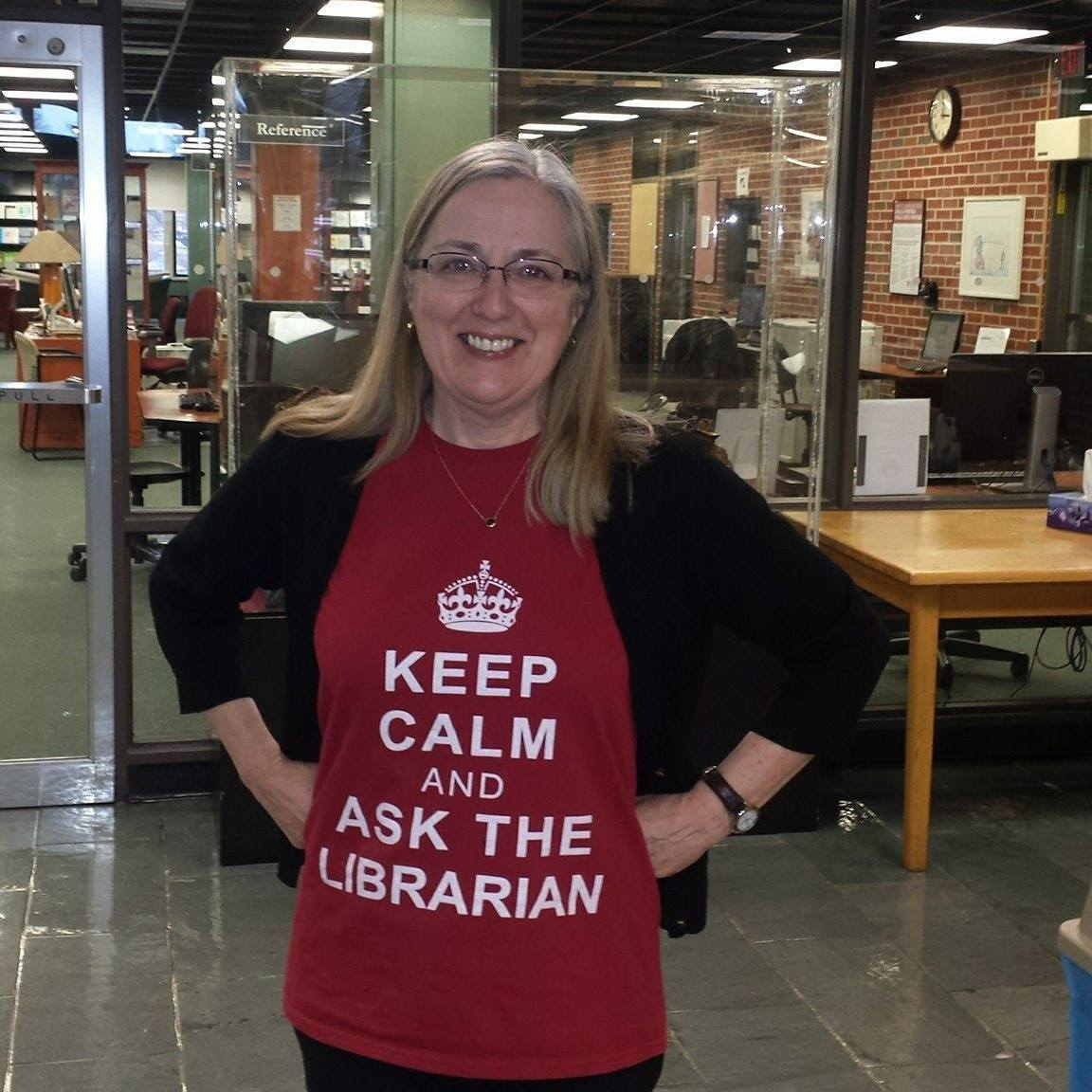 Diane Campbell wearing a Keep Calm and Ask a librarian shirt