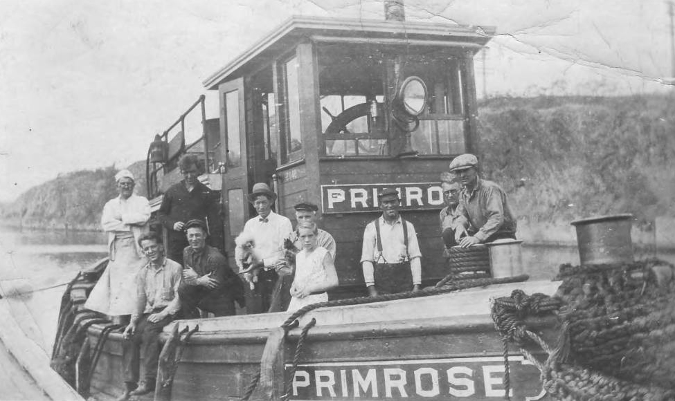"Visitors and crew on the Cornell tug ""Primrose"""