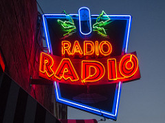 "photograph of neon sign reading ""Radio, Radio"""