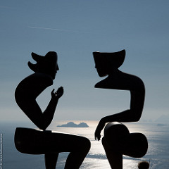 abstract sculpture depicting two people talking