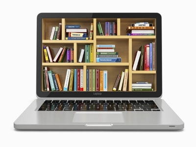 Books stacked in screen of laptop