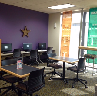 three computer workstations in the library