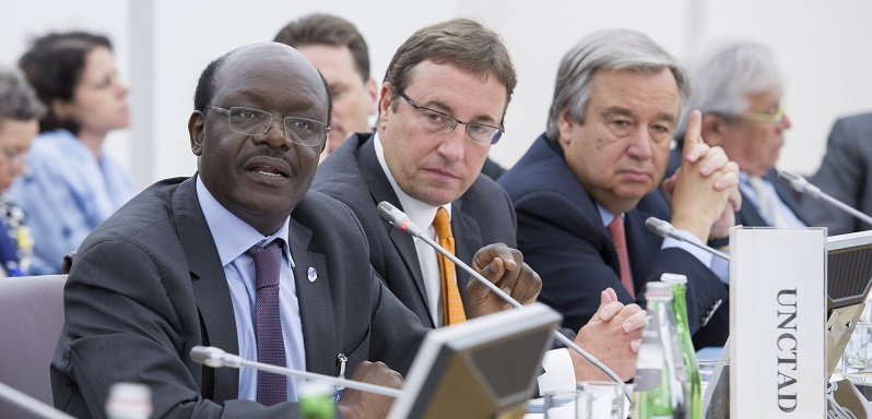 Mukhisa Kituyi (left), Secretary-General of the UN Conference on Trade and Development (UNCTAD), addresses the 2014 meeting of the Chief Executives Board; UN Photo 587927