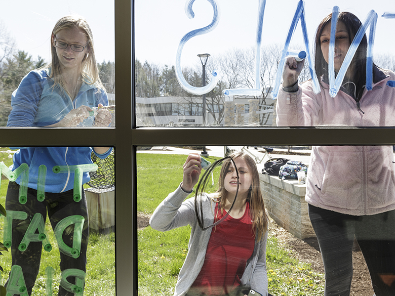 students looking through a window