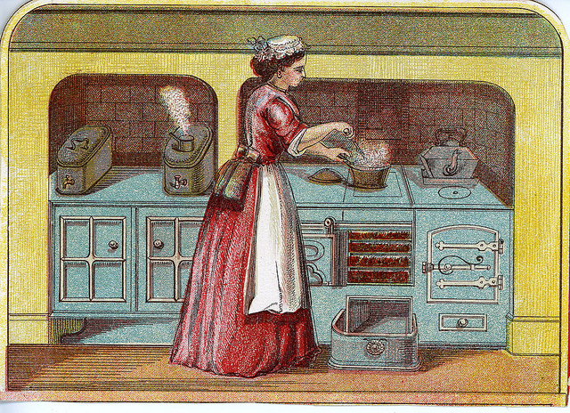 Color print of woman in a long old-fashion dress with cap on her hair, stirring a pot in a large old stove