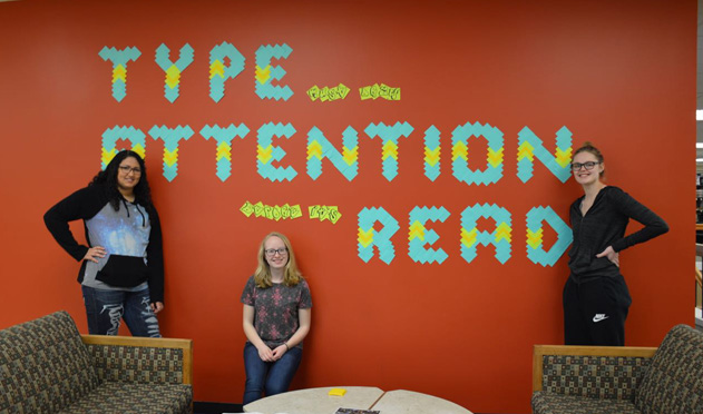 Typography students exhibit of message made of post-its