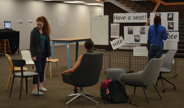 students trying out furniture in the Have a Seat! exhibit