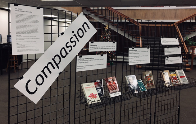 library exhibit of books on the topic of compassion