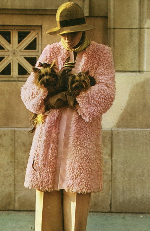 Image of woman holding dogs in coat by Rykiel