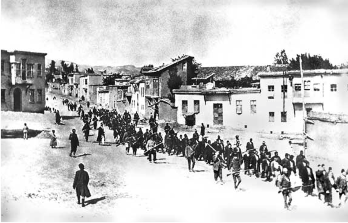 IMAGE - Armenians are marched to a nearby prison in Mezireh by armed Turkish soldiers. Kharpert, Armenia, Ottoman Empire - April, 1915.
