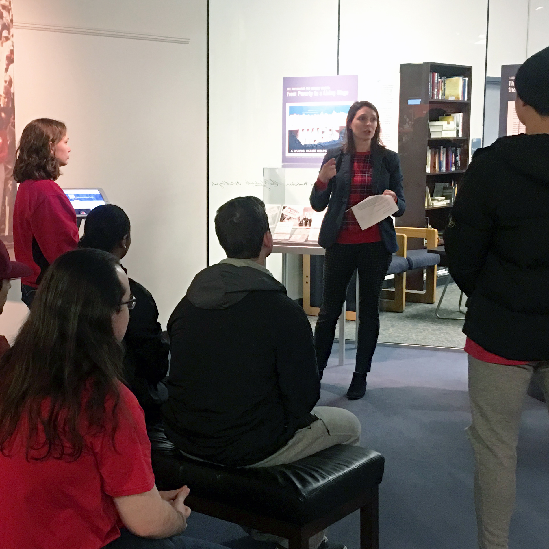 Archivist teaching a class in the exhibition gallery