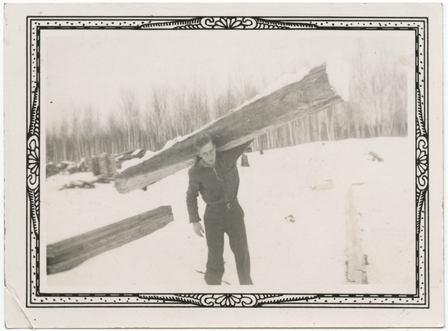 Unidentified man hauling lumber, Company 719, Camp S-51, Brimson