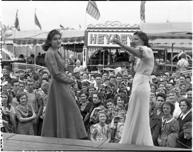 Two women putting on show at the Midway