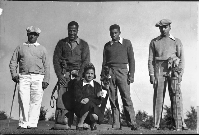 Group of golfers; Rosella Ellis in foreground, Jimmy Slemmons, second from left