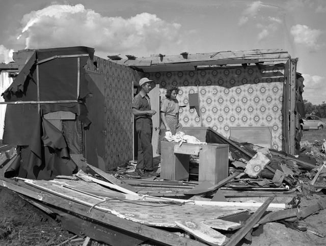 A couple going through their house after it was damaged during a June 19, 1951 tornado outbreak in Anoka and McLeod counties.