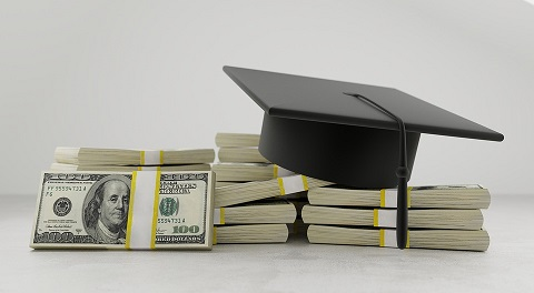 Pile of money with graduation cap on top depicting the high cost of education.