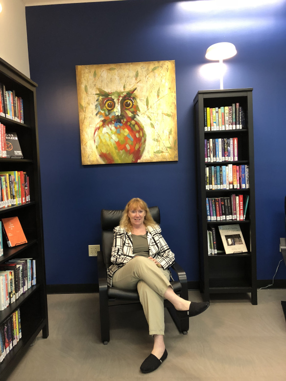 Dean Carol Hixson sitting in the Diversity Burrow at Wimberly Library.