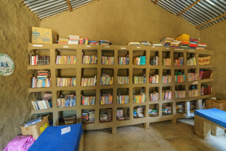 Interior of an adobe school library with buit in shelves