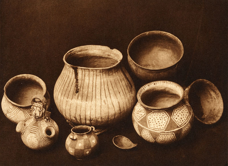 Photographic still life of Native American pottery.