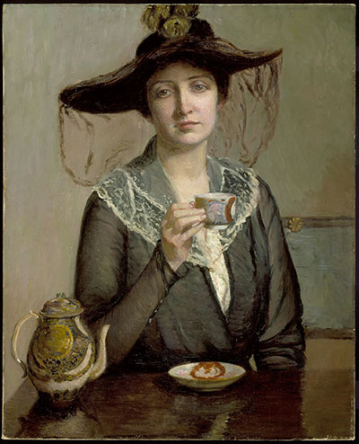 Portrait of a woman wearing a hat and drinking tea.
