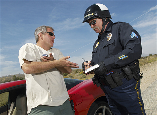 Police Officer writes a ticket