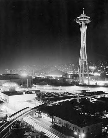 Space Needle, the Alweg Monorail System, and the Century 21 Exposition grounds illuminated at night, Seattle, 1962