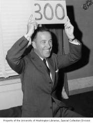 Senator Henry M. Jackson, as chairman of the Democratic National Committee, holding a sign indicating Senator John F. Kennedy has reached 300 electoral votes in the presidential election, Washington, D.C., November 8, 1960