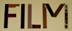 "The word ""FILM"" spelled out with camera film."