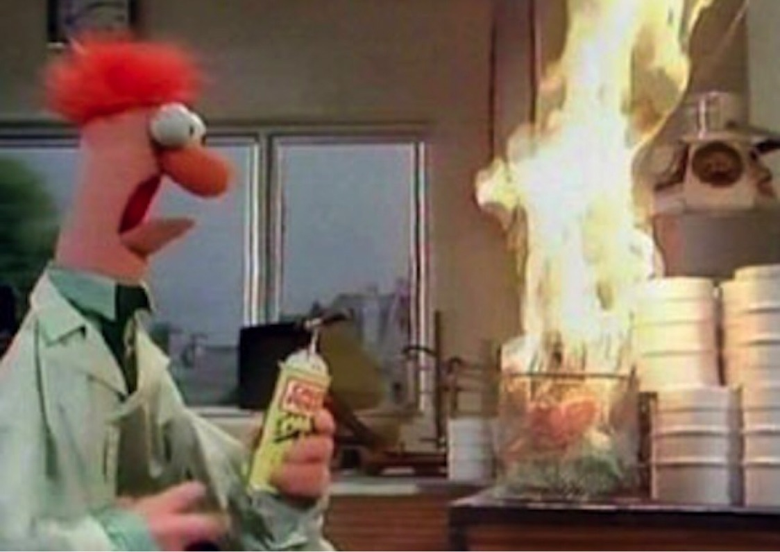 Beaker from the Muppets performing an experiment