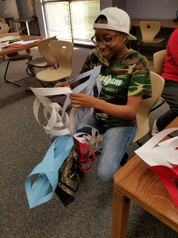 student making paper wreath