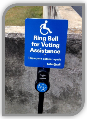 "Image of a blue ballot call sign with a white icon of a person in a wheelchair centered at the top. The sign reads, ""Ring Bell fro Voting Assistance"" in big letters and underneath in smaller letters, ""Toque para obtener ayuda."" """