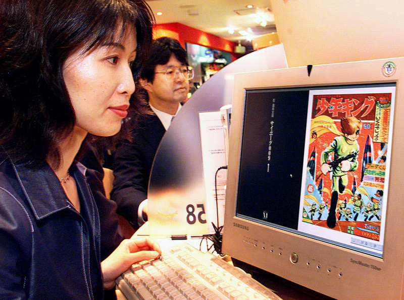 Image photograph of woman reading a comic book online