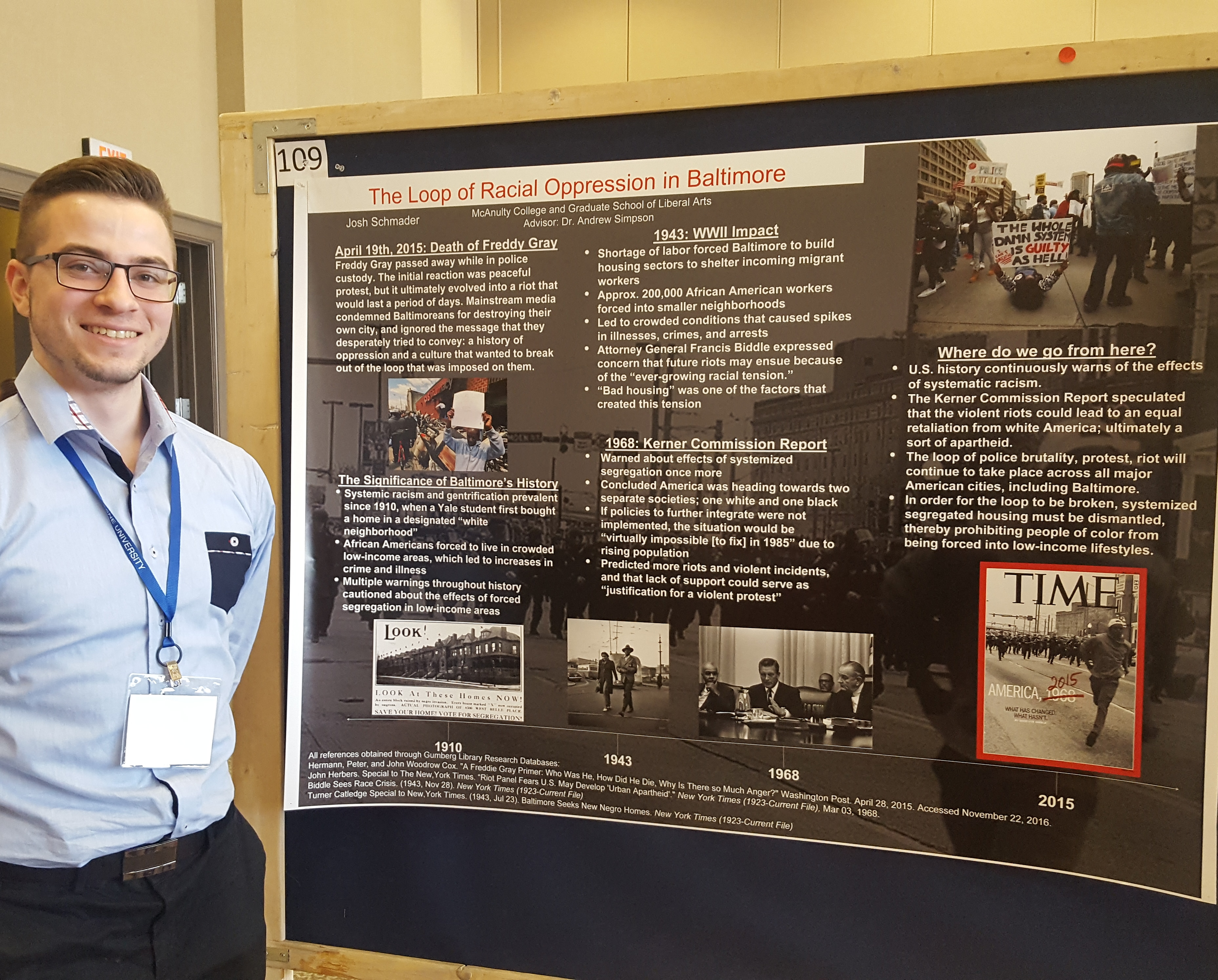 Josh Schmader standing next to his award-winning poster