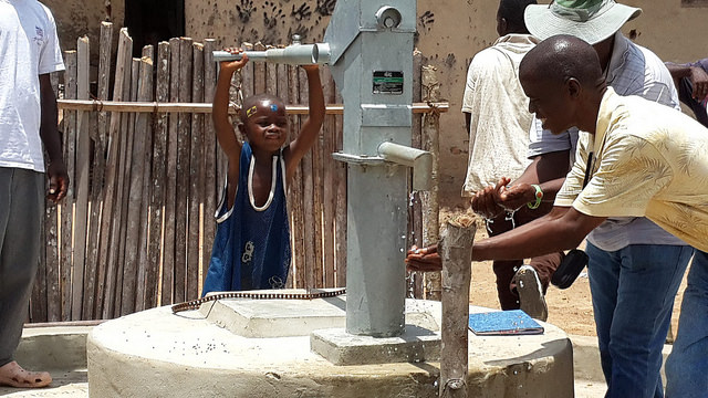 Child operating a water pump