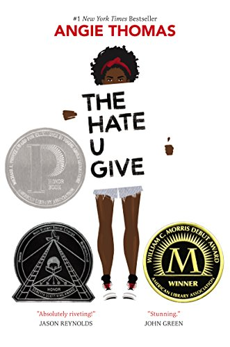 Black girl holding sign saying The Hate You Give