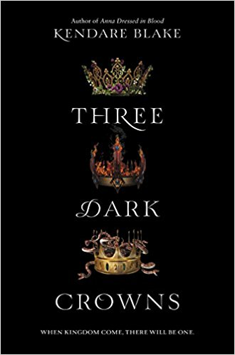 Stack of three gold crowns on black cover