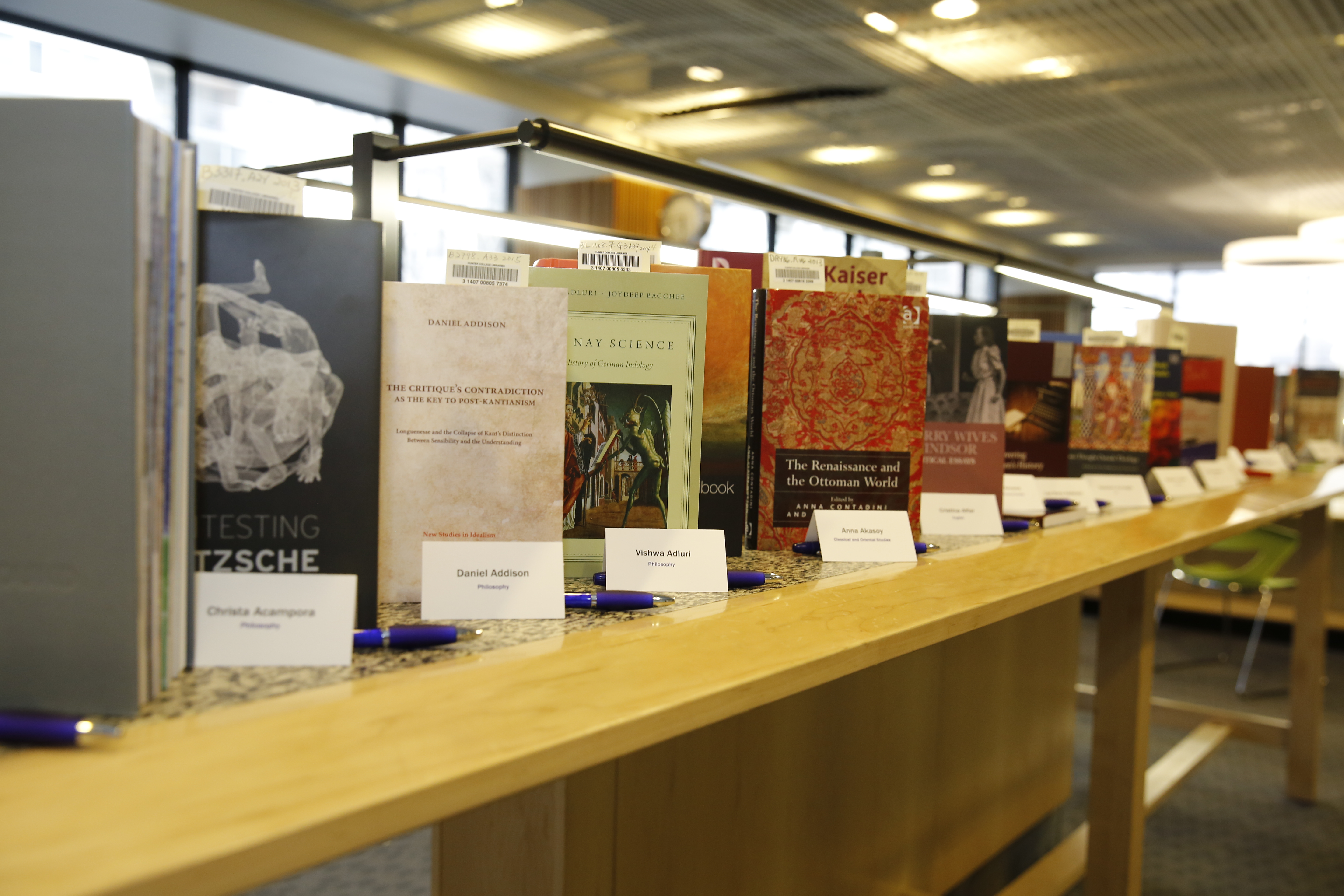 books by Hunter College faculty members on a table