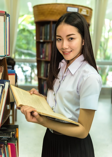 Student in library. Pixabay CC image.