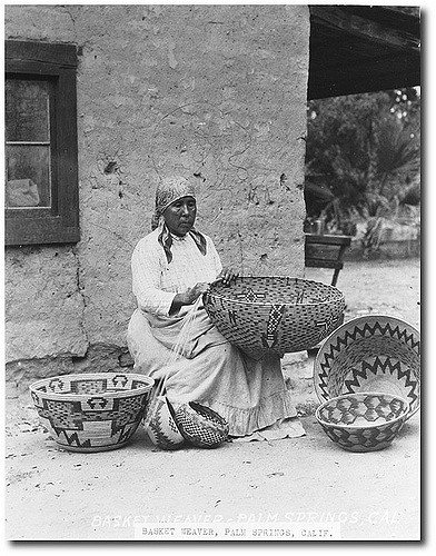 Indian Basket Weaver Sitting Down near an Adobe Building