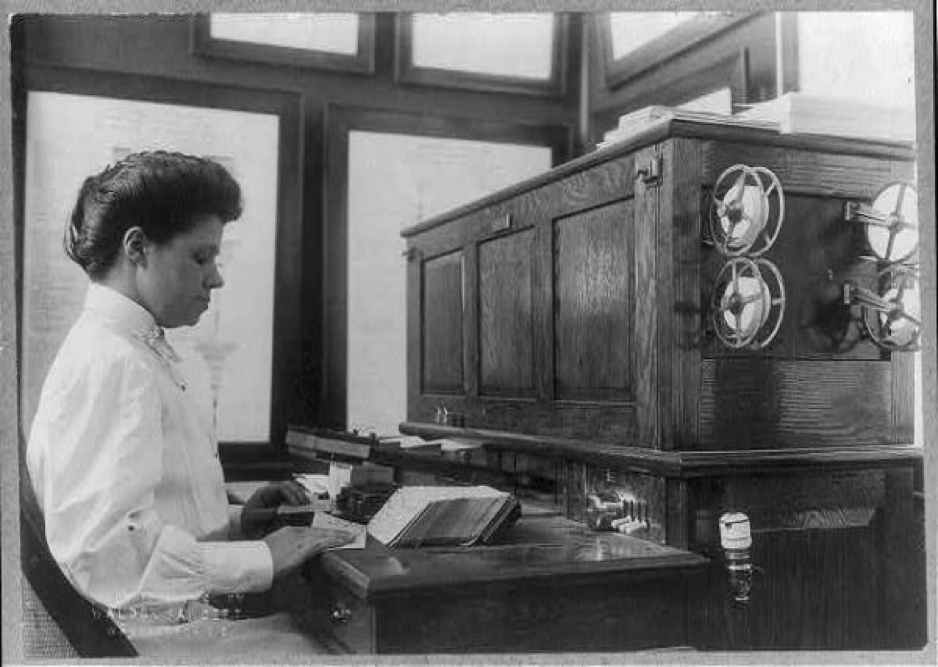 A Census Bureau employee sorts punch cards for tabulation by the agency's electronic tabulators.