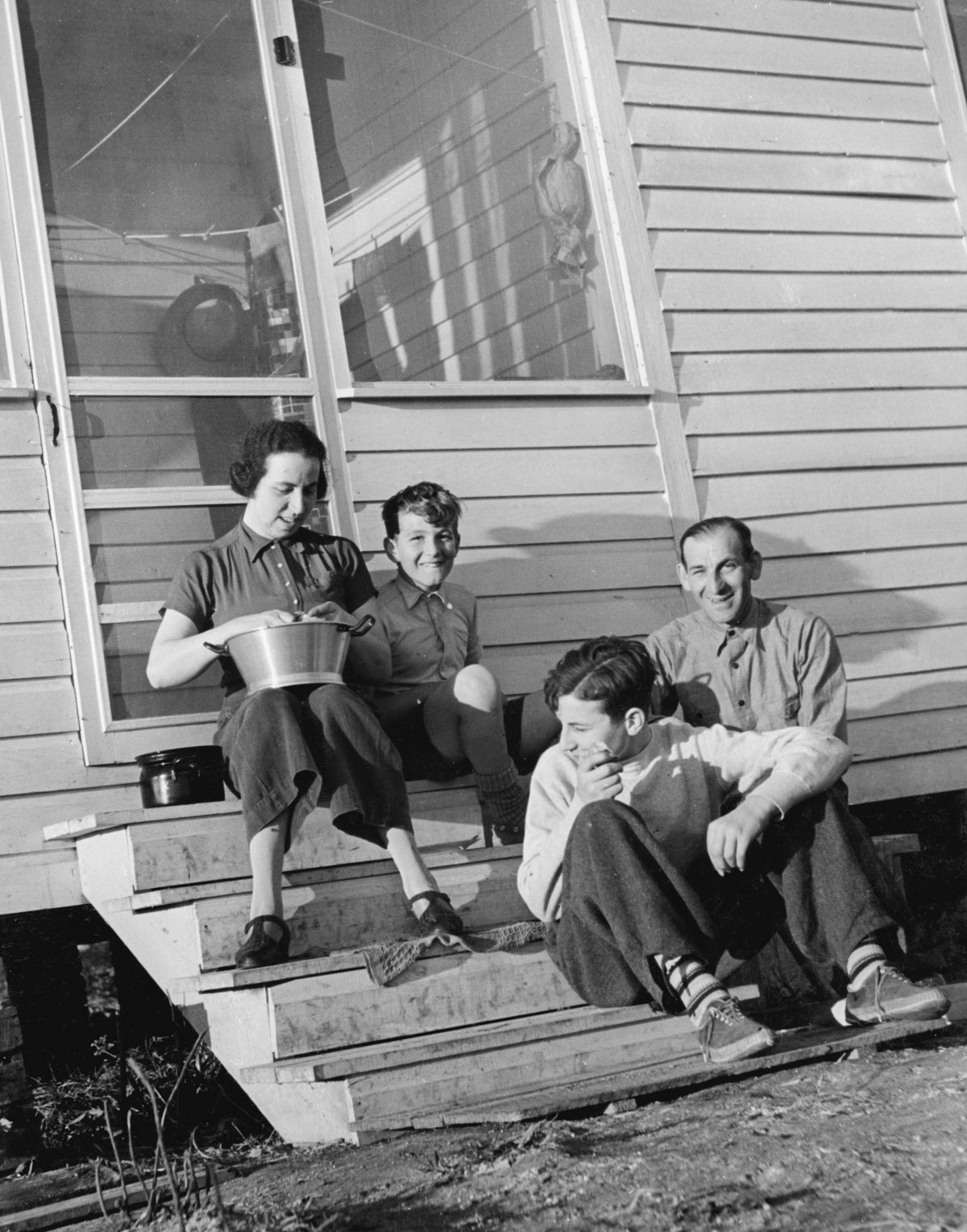 The Loeb Family on their stoop in Van Eeden
