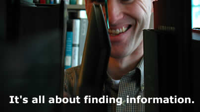 "image of a happy man looking at books on the shelves, caption is ""it's all about finding information"""