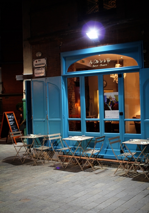 exterior of a french cafe at night