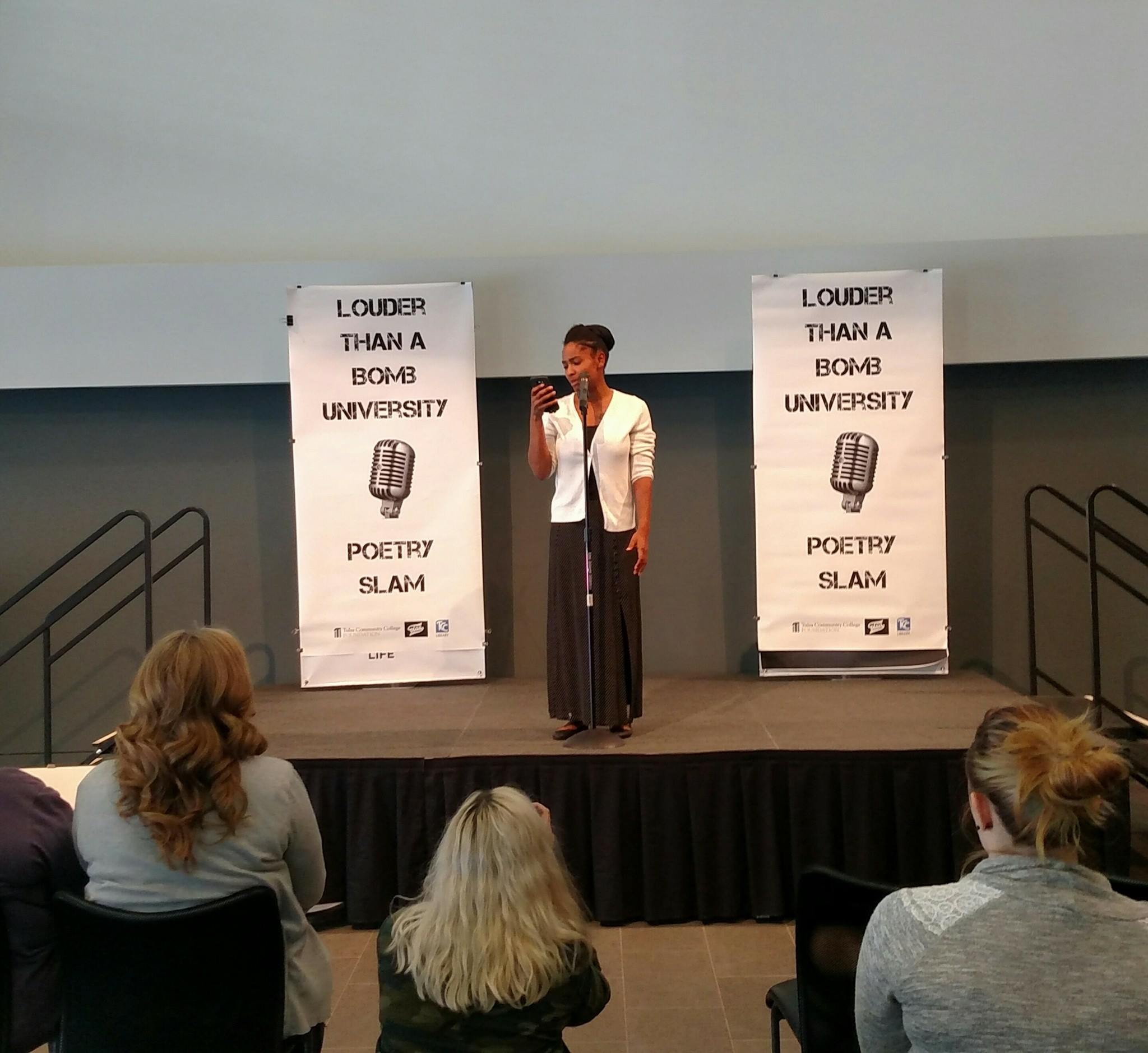 photo of a Student performing original poetry at the poetry slam event, Louder than a bomb university