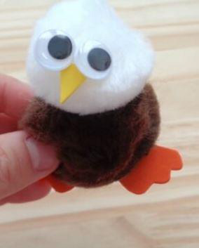 Arts and crafts creation: eagle made of puff balls and felt