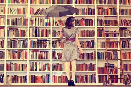 Woman in front of Bookshelf
