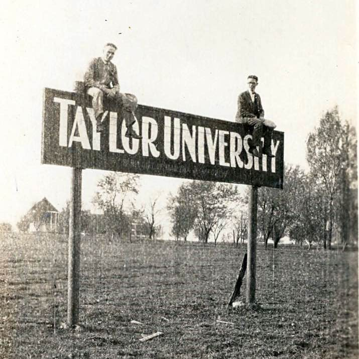 students on old Taylor sign