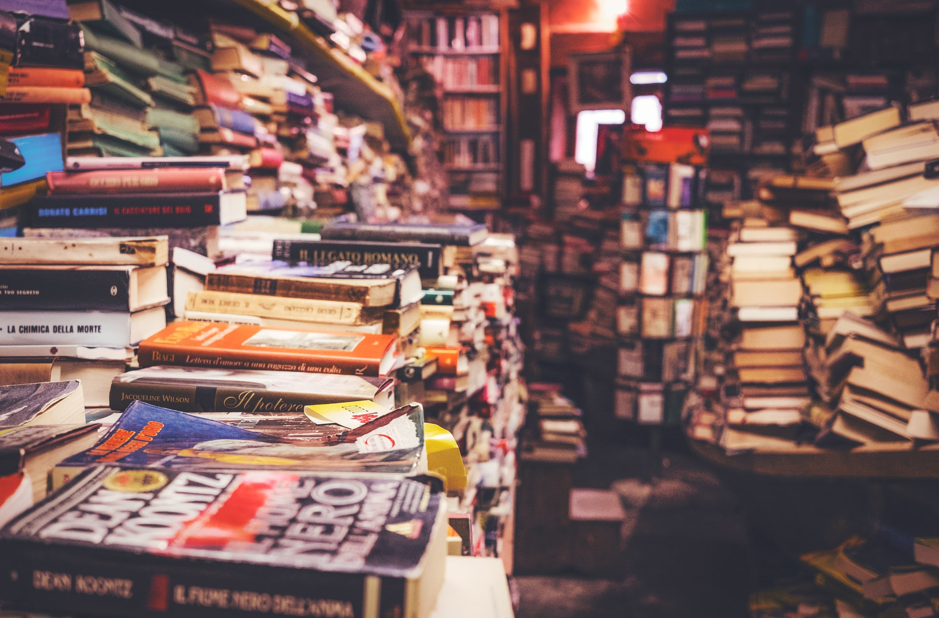 Image of stacks of books. Photo by Cristina Gottardi on Unsplash